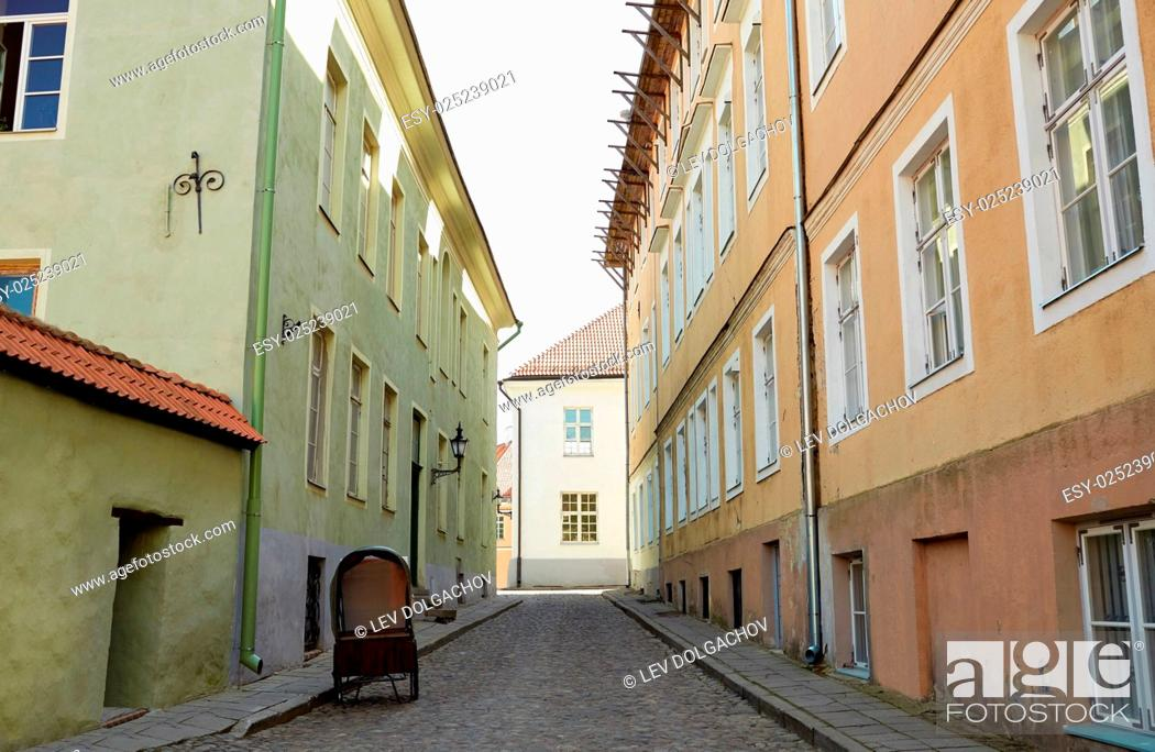 Stock Photo: travel, tourism and european architecture concept - old town street with abandoned gig in tallinn city in estonia.