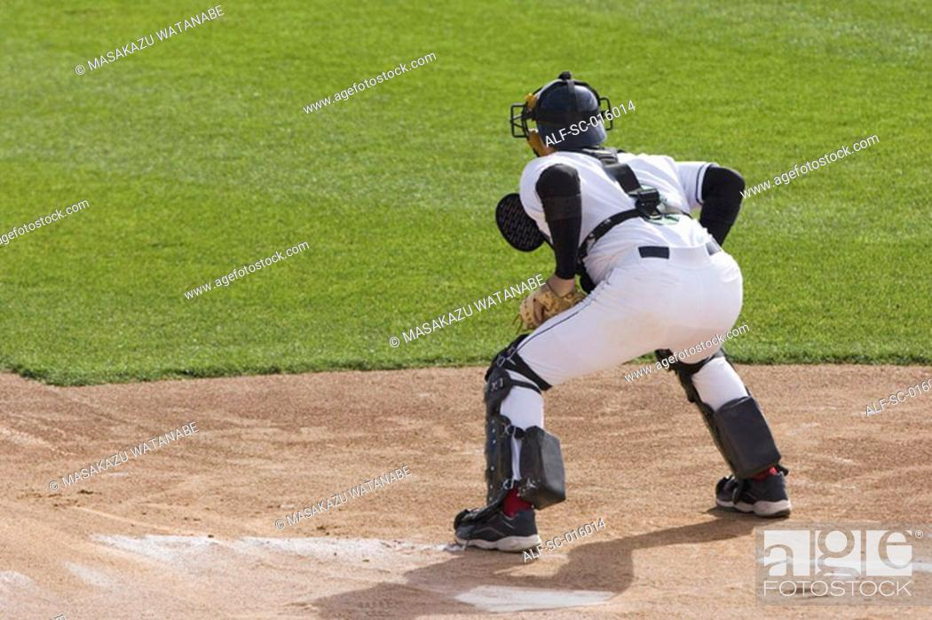 Stock Photo: Catcher ready for the throw into home.