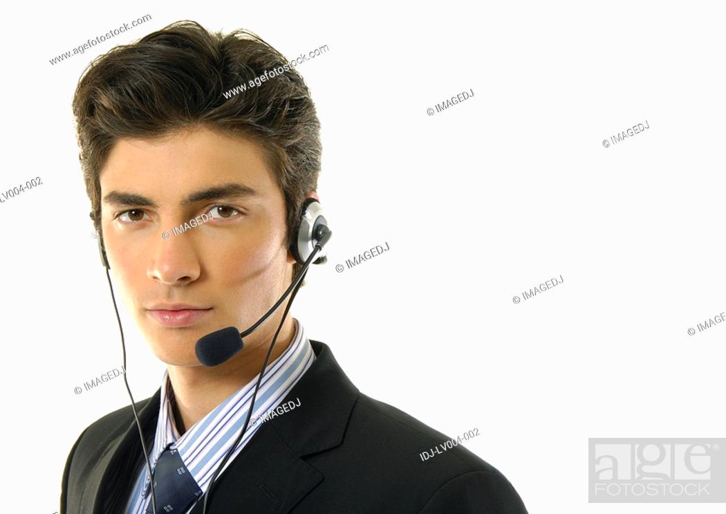 Stock Photo: Portrait of a businessman wearing a headset.