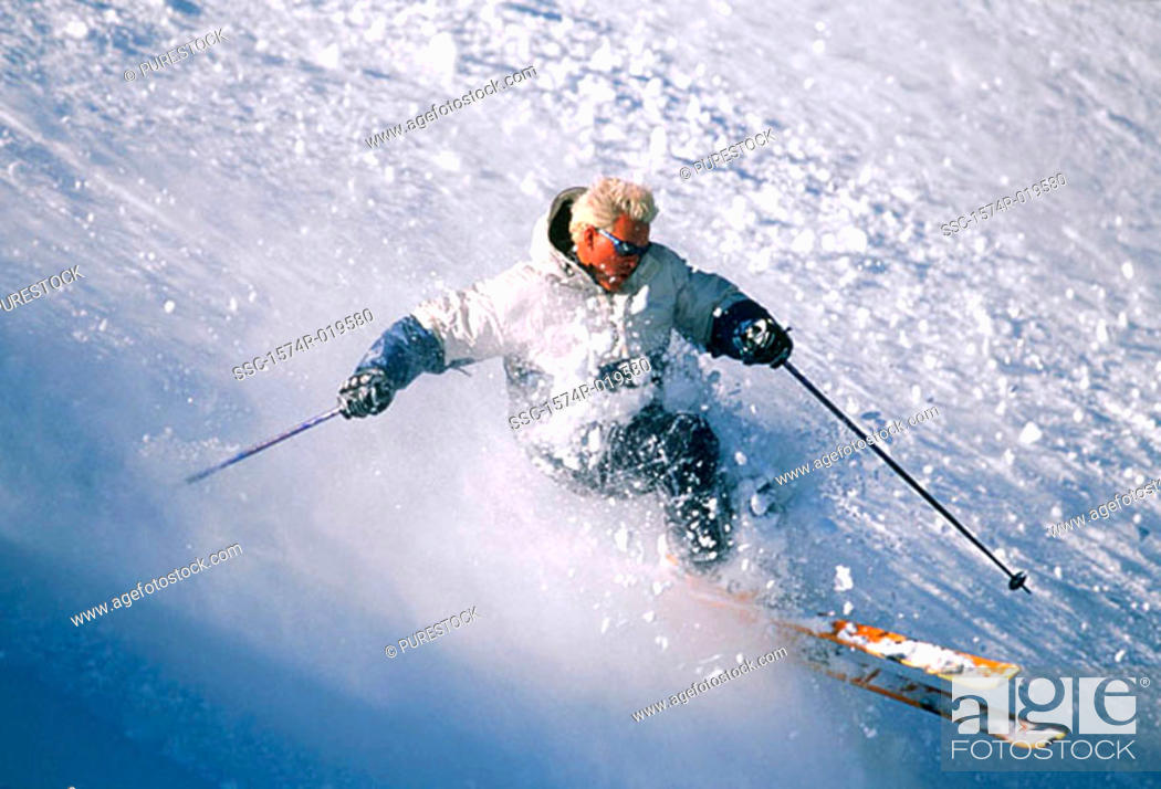 Stock Photo: High angle view of a young man skiing.