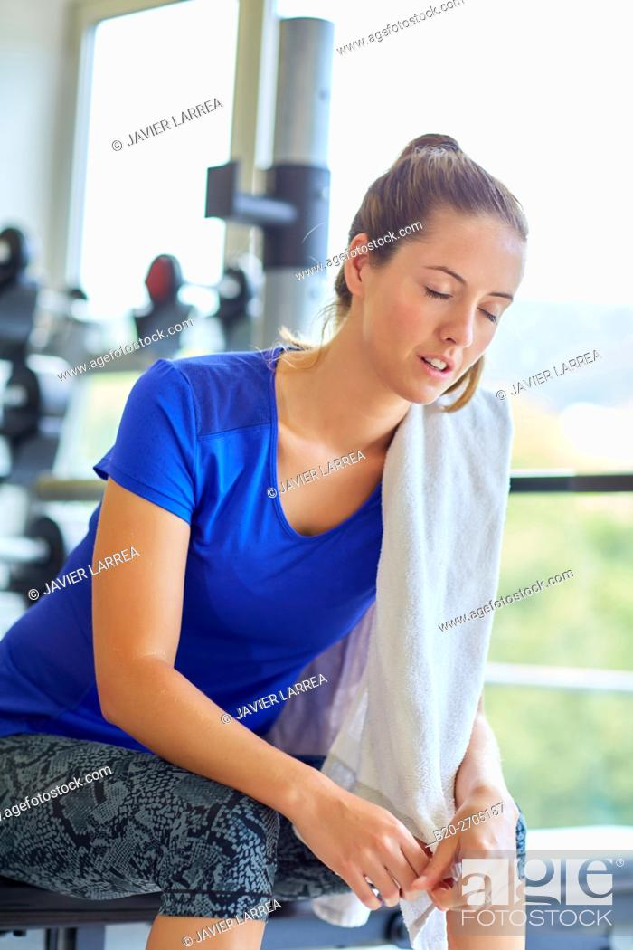 Stock Photo: Woman resting in gym.
