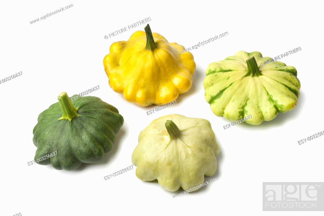 Stock Photo: Four types of Pattypan Squash on white background.
