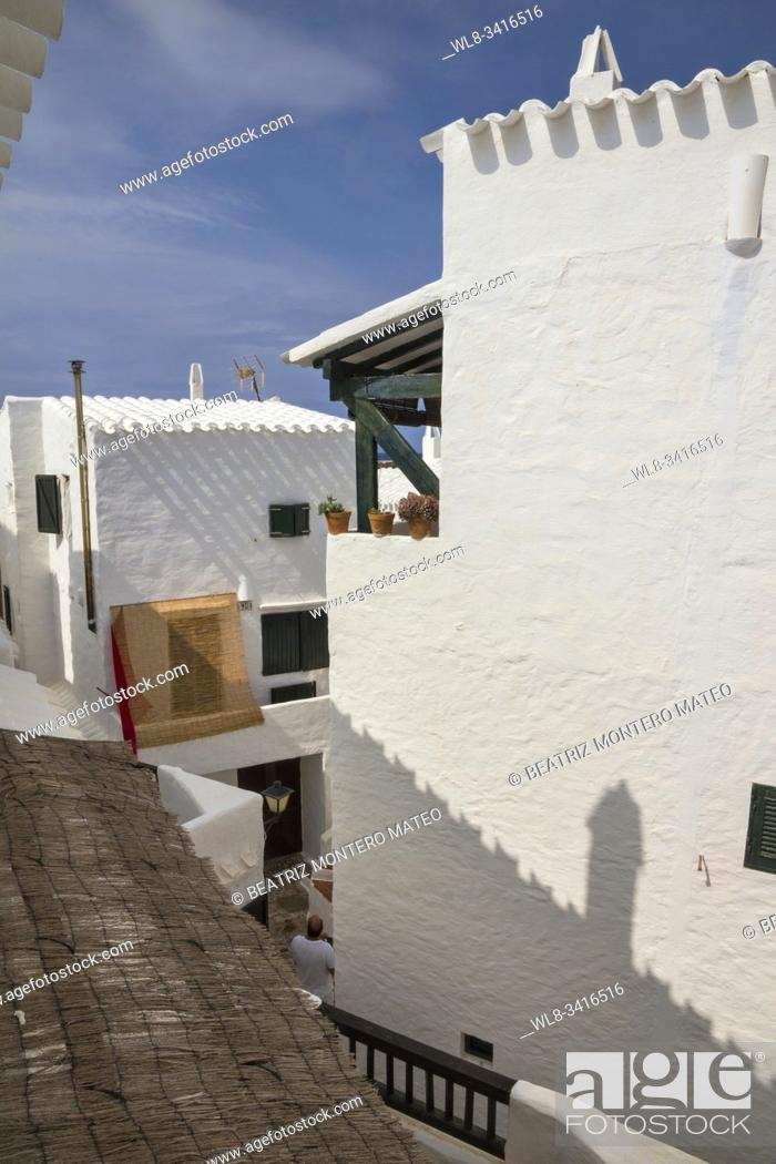 Stock Photo: Typical Binibeca's street. Binibeca is one of the most beautiful cities in Menorca, Baleares (Spain). It's streets are completely white.