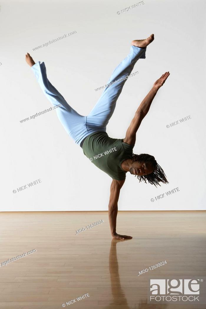 Stock Photo: Ballet Dancer on one hand.