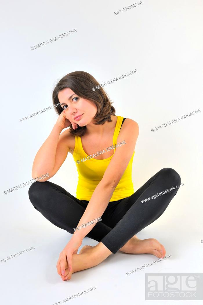 Stock Photo: portrait of a pretty sporty woman in studio.