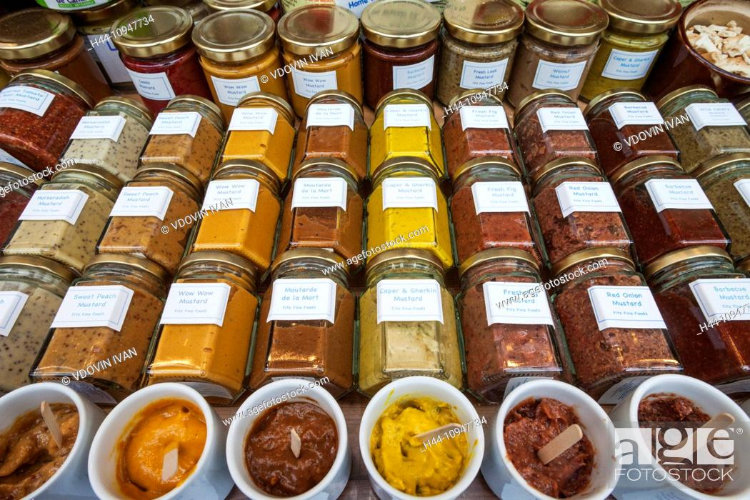 Stock Photo: England, London, Southwark, Borough Market, Display of Mustard Jars.