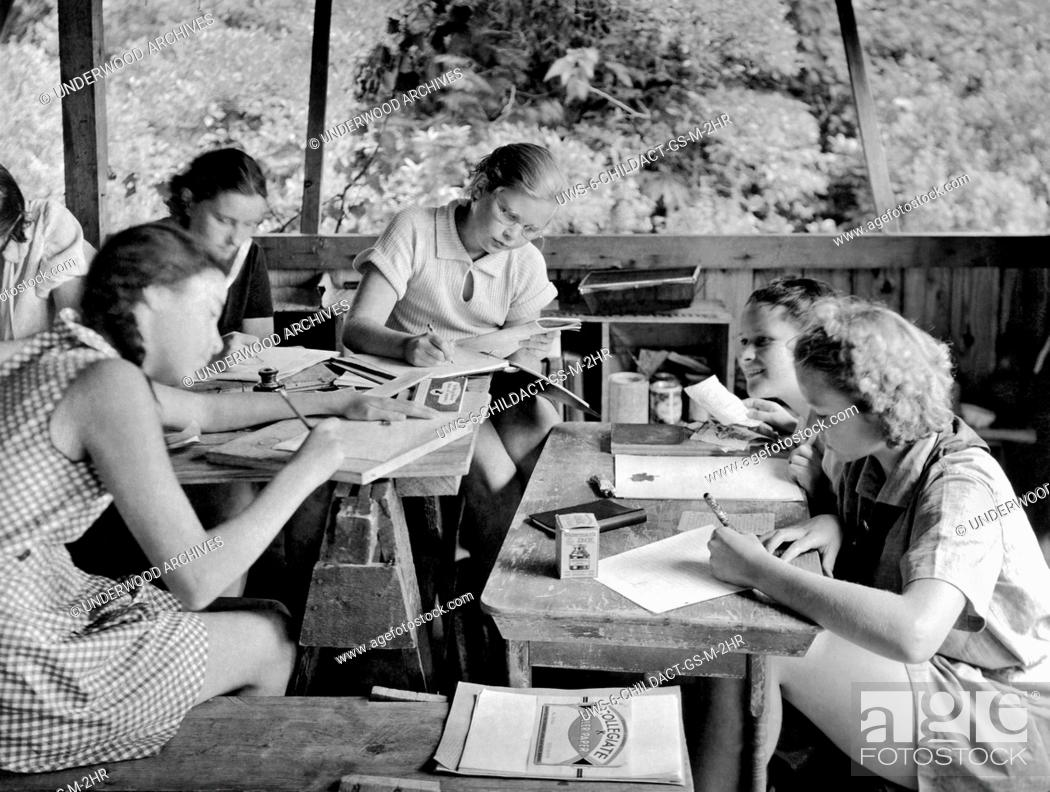 Stock Photo: United States: c. 1929. An art class in a Girl Scout Sylvan Camp.