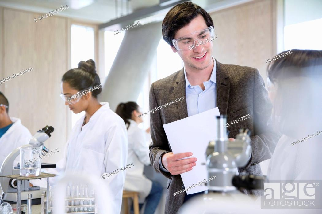 Stock Photo: Science professor helping college student in science laboratory classroom.