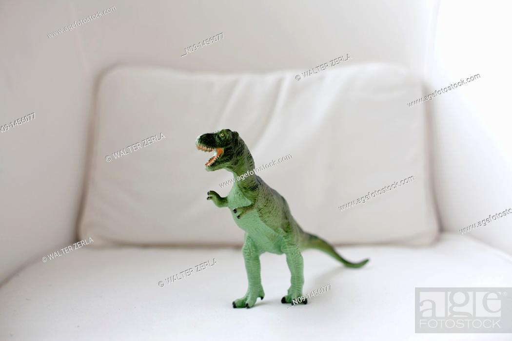 Stock Photo: Little dinosaur on coach.