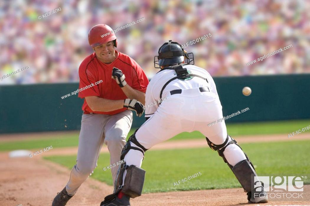 Stock Photo: Baseball player charging the catcher.