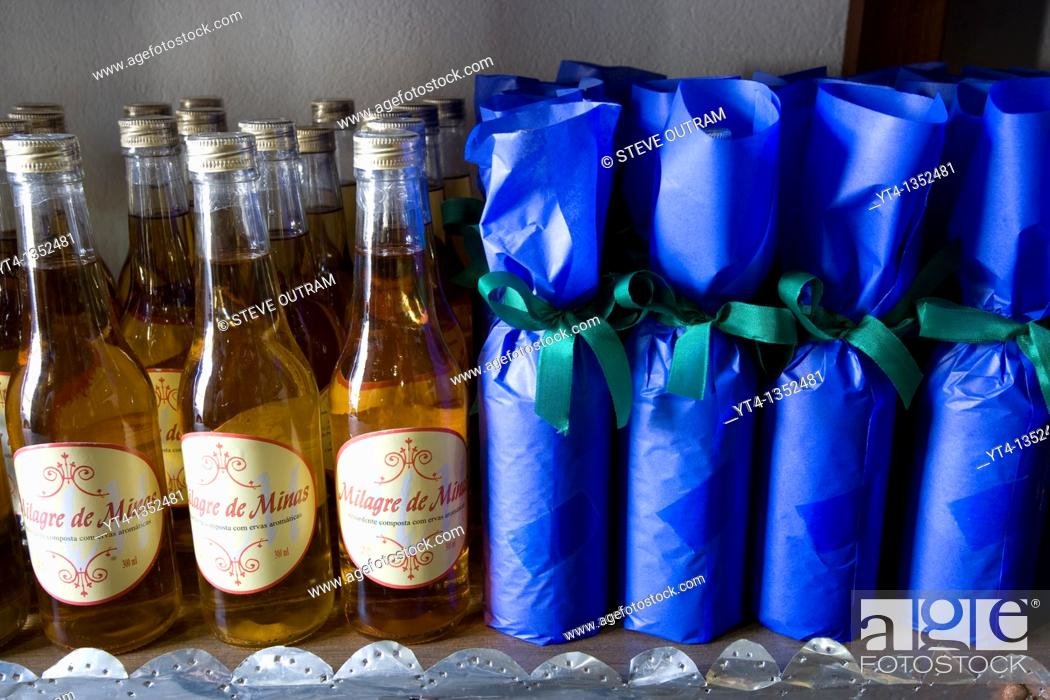 Stock Photo: Bottles of locally made Cachaca on sale at a Cachacaia shop, Ouro Preto village, Minas Gerais, Brazil.