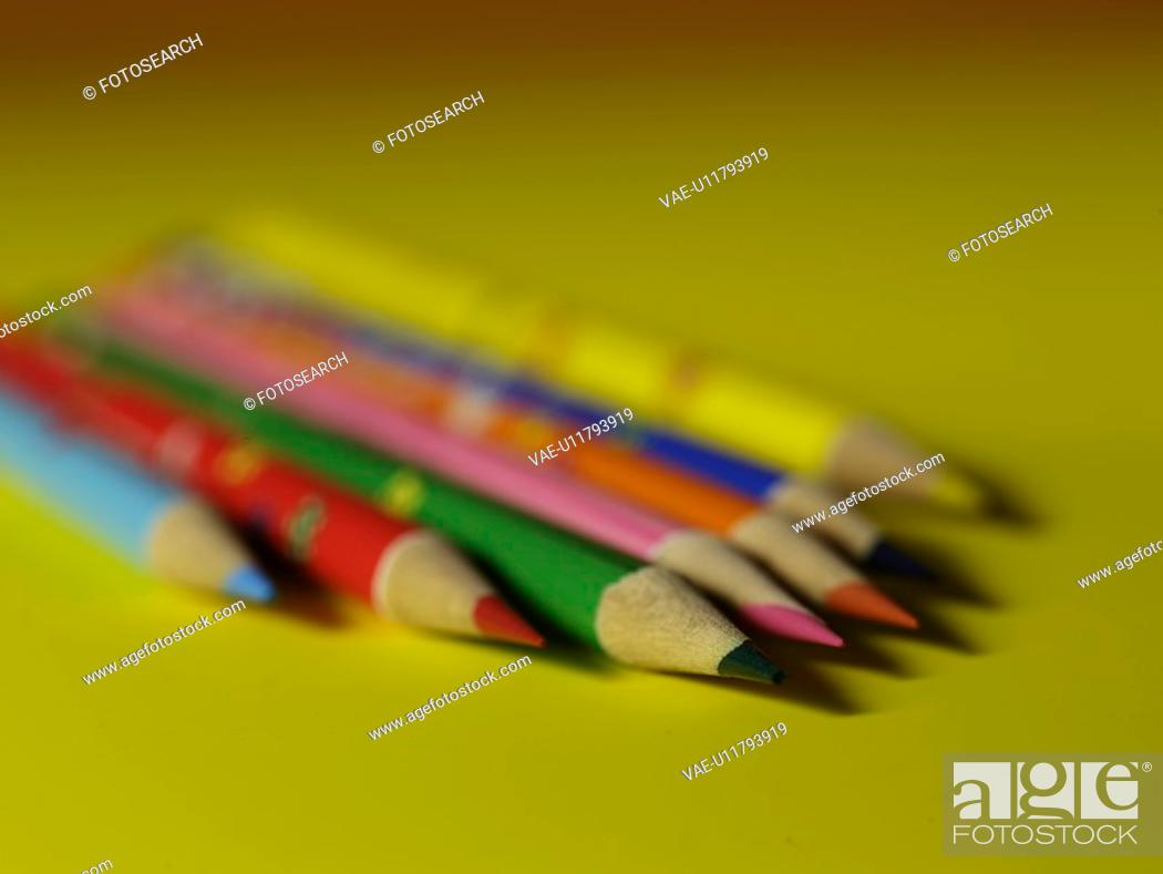 Stock Photo: writing instrument, multi colored pencil, school stationery, stationery, business supplies, pencil, artifact.