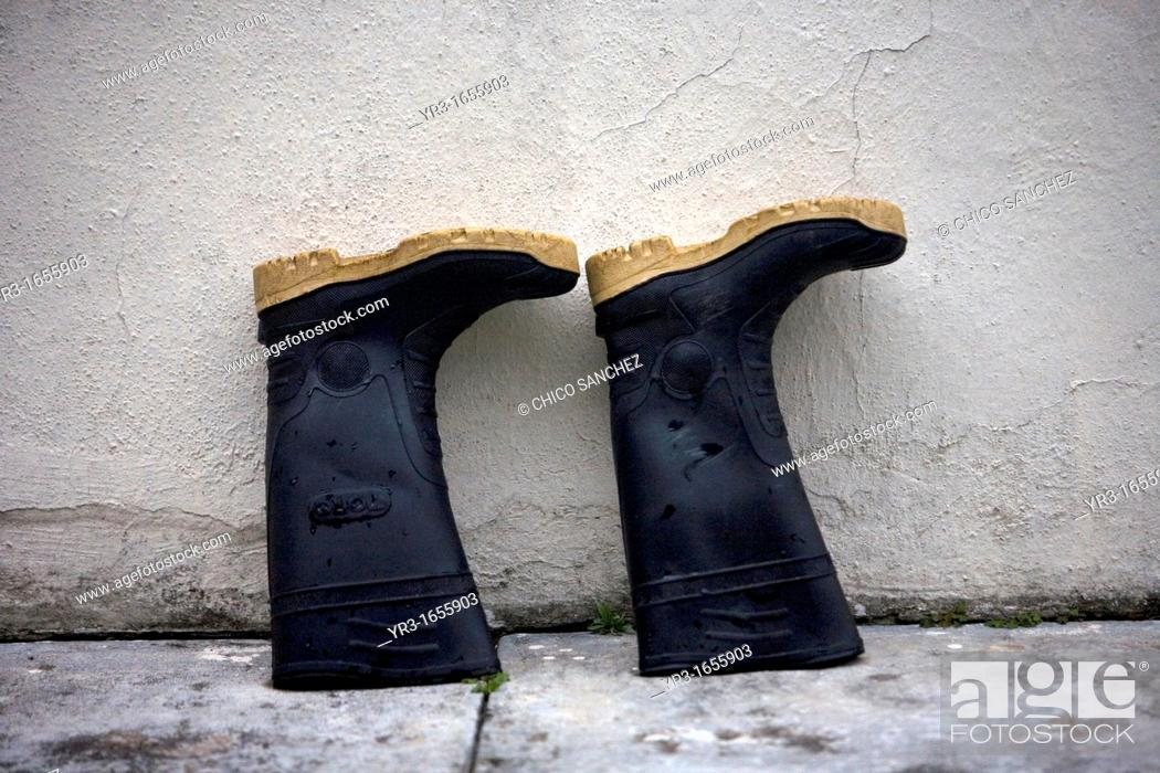Stock Photo: Boots dry outside a shelter in El Triunfo Biosphere Reserve in the Sierra Madre mountains, Chiapas state, Mexico.