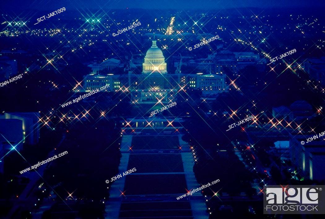 Stock Photo: The U.S. Capitol and National Mall at night as seen from the top of the Washington Monument.