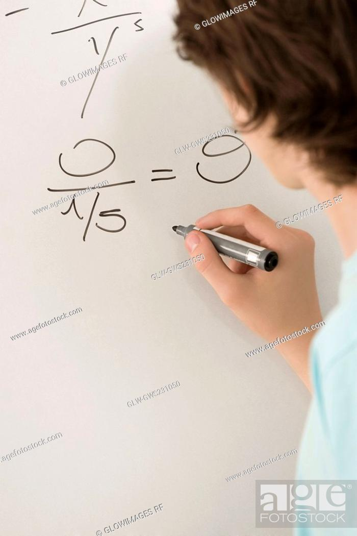 Stock Photo: Close-up of a teenage boy writing on a whiteboard.