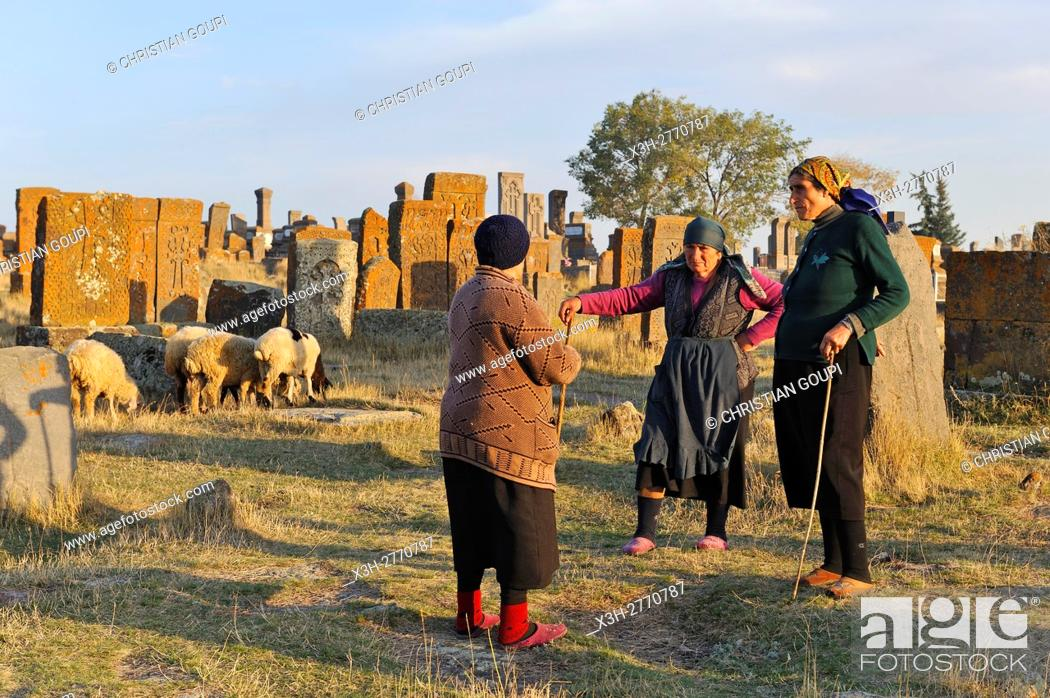 Stock Photo: shepherdess at Noratus cemetery (the largest surviving cemetery with khachkars in Armenia), near Lake Sevan, Gegharkunik region, Armenia, Eurasia.