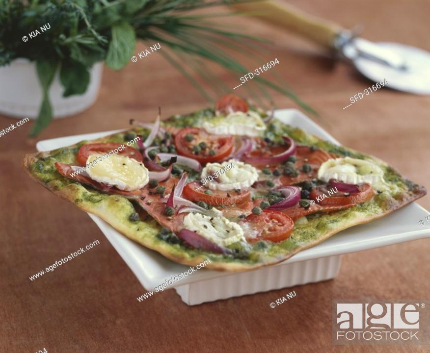 Stock Photo: Goat's cheese and smoked salmon pizza.
