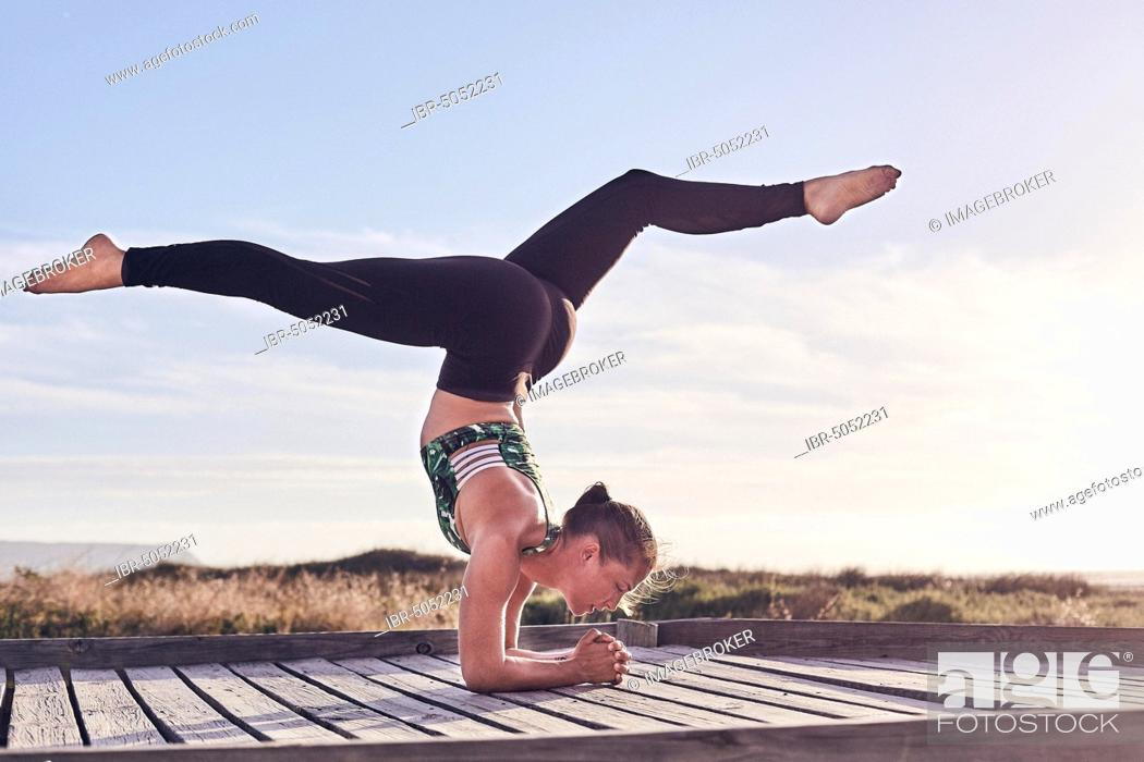 Stock Photo: Young woman, yoga, gymnastics on the beach, Cape Town, South Africa, Africa.