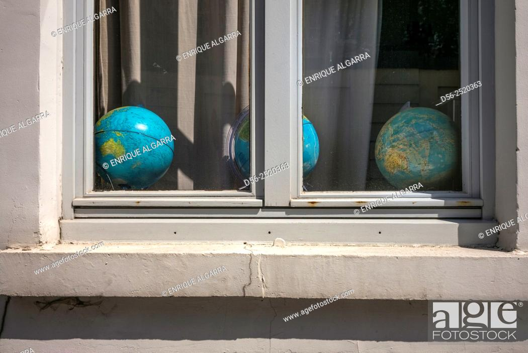 Stock Photo: globes in a window, Bruges, Belgium.