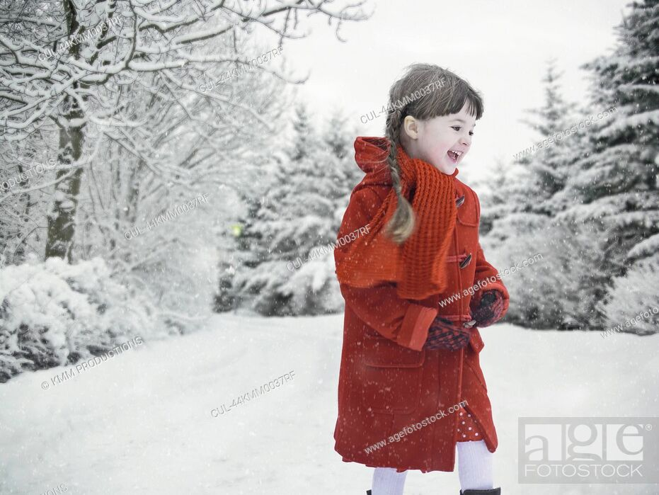 Stock Photo: Smiling girl playing in snow.