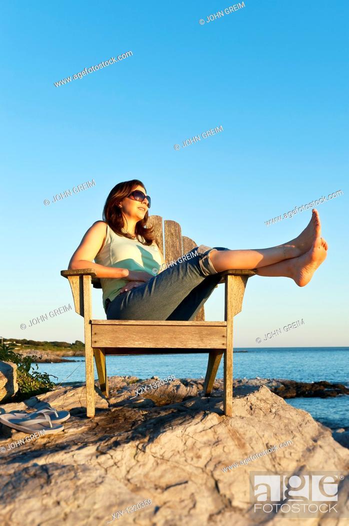 Stock Photo: Woman enjoys the coastal view, Newport, Rhode Island.