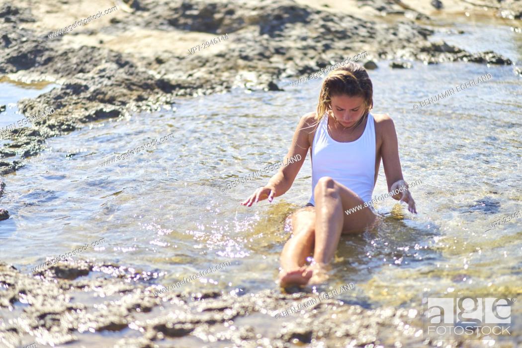 Imagen: attractive woman taking a bath in sea water. Dutch ethnicity. At holiday destination Chrissi Island, Crete, Greece.