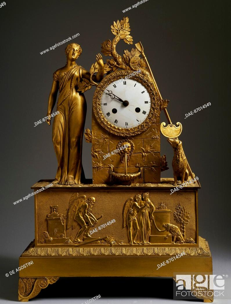 Stock Photo: Empire-style clock depicting Diana standing by a fountain inlaid with the clock face, on a pedestal base decorated in bas-relief depicting Time breaking Cupid's.