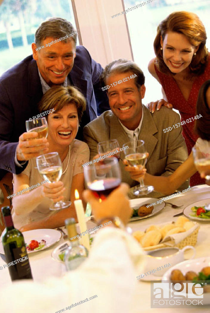 Stock Photo: Group of people celebrating with glasses of wine.