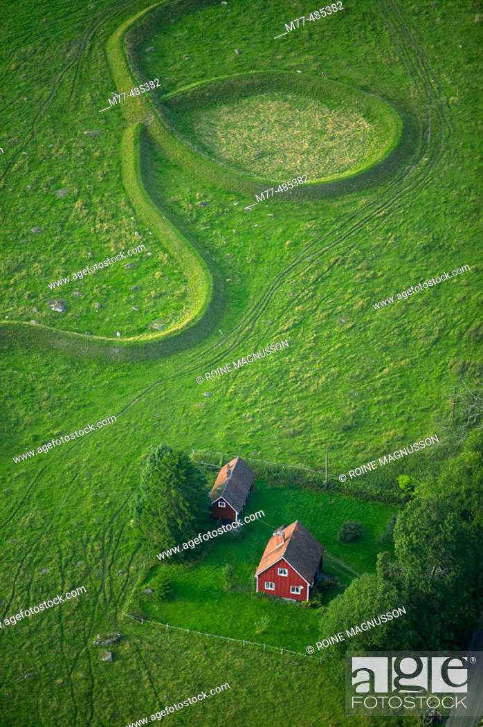 Stock Photo: Red house and art formations in the background, aerial view. Vanås. Skåne. Sweden.