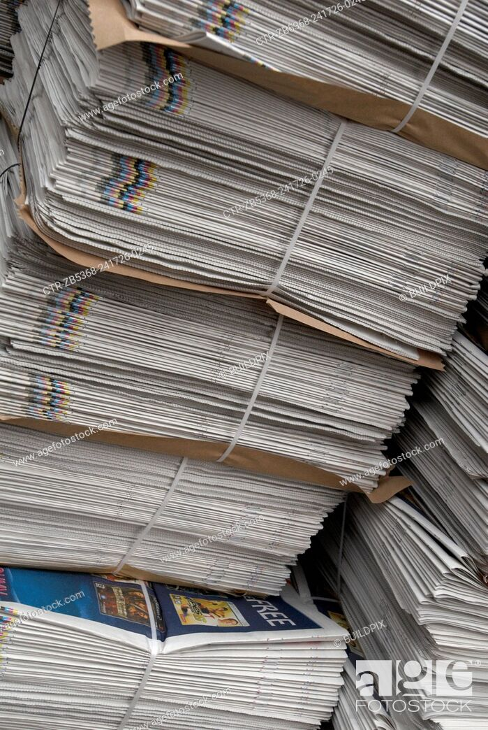 Imagen: Stacks of newspapers.