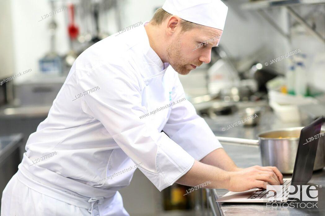 Imagen: Chef with laptop computer, Cook in cooking school, Cuisine School, Donostia, San Sebastian, Gipuzkoa, Basque Country, Spain, Europe.