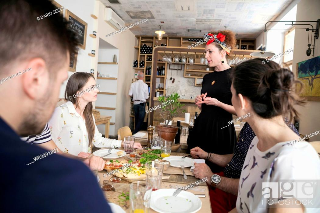 Stock Photo: Waitress taking order in restaurant.