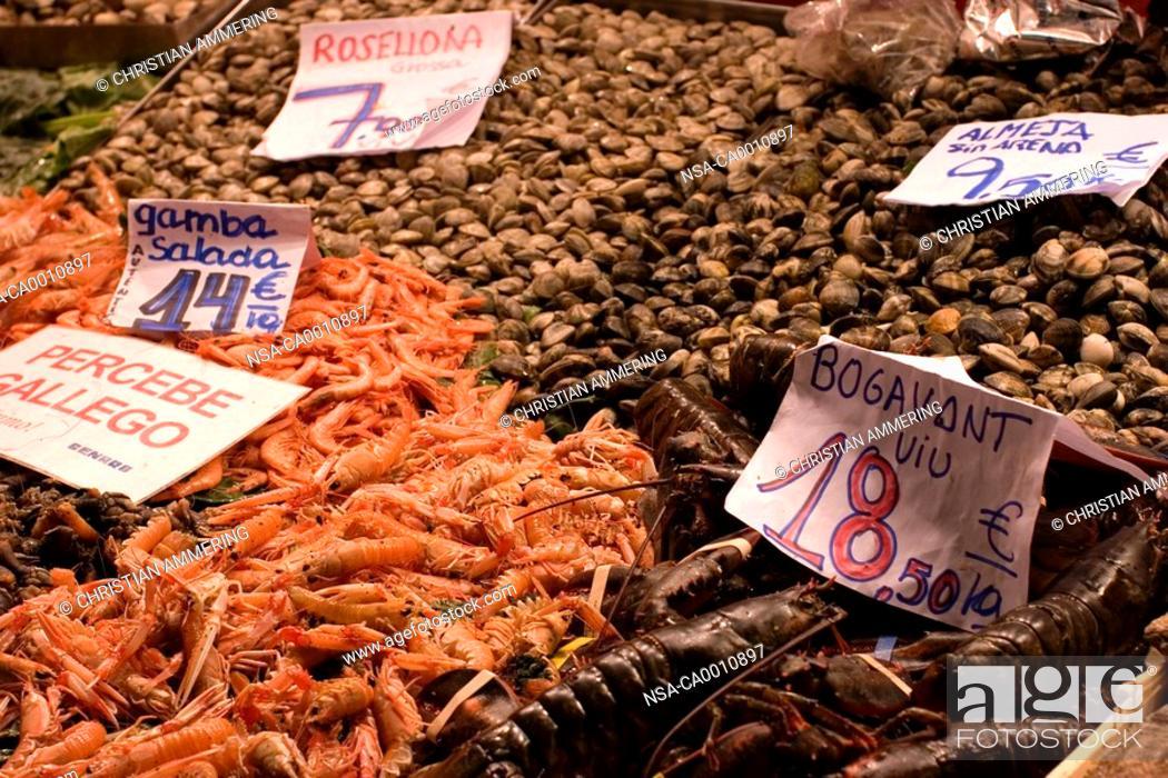 Stock Photo: Market stalls at the Mercat de la Boqueria in Barcelona with fresh fish.