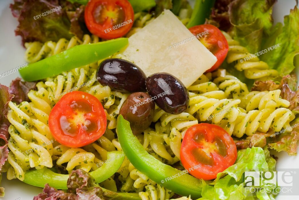 Stock Photo: fresh healthy homemade italian fusilli pasta salad with parmesan cheese, pachino cherry tomatoes, black olives and mix vegetables.