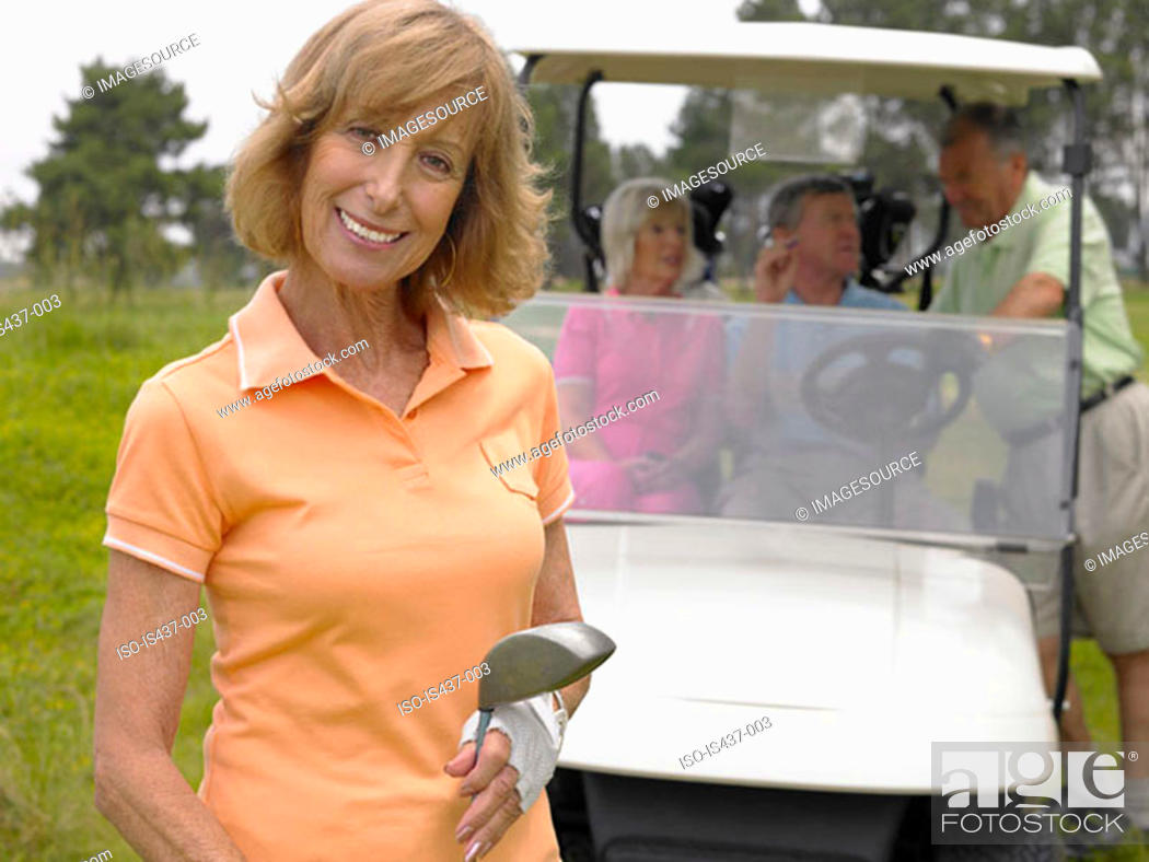 Stock Photo: Woman in front of golf cart.
