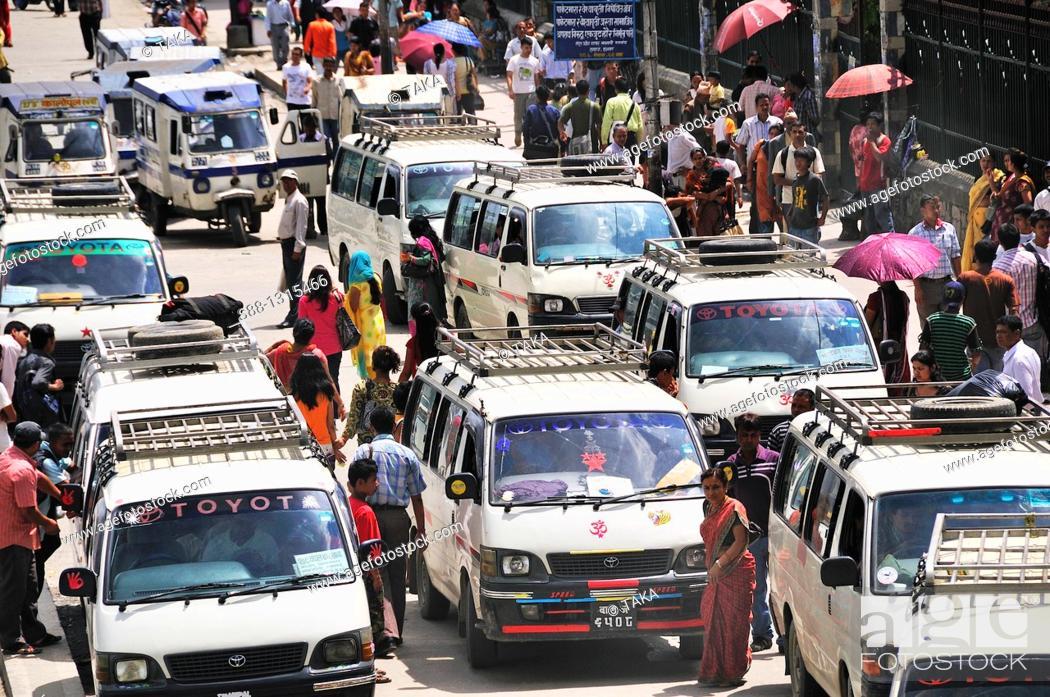 Stock Photo: Mini buses are the major public transportation in Kathmandu at Kanthpas street.