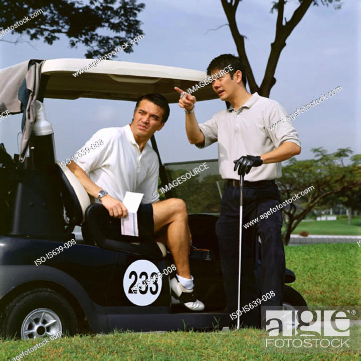 Stock Photo: Two men playing golf.
