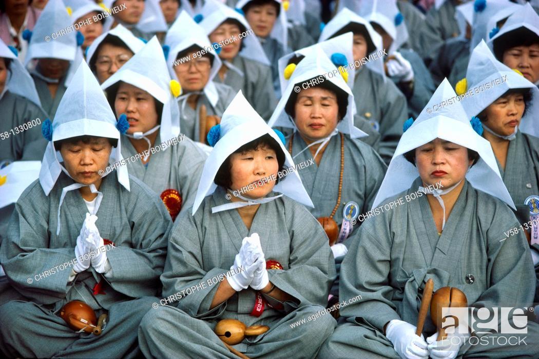 Stock Photo: NUNS IN PRAYER, BUDDHA'S BIRTHDAY FESTIVAL, YOIDO SQUARE, SEOUL, KOREA.