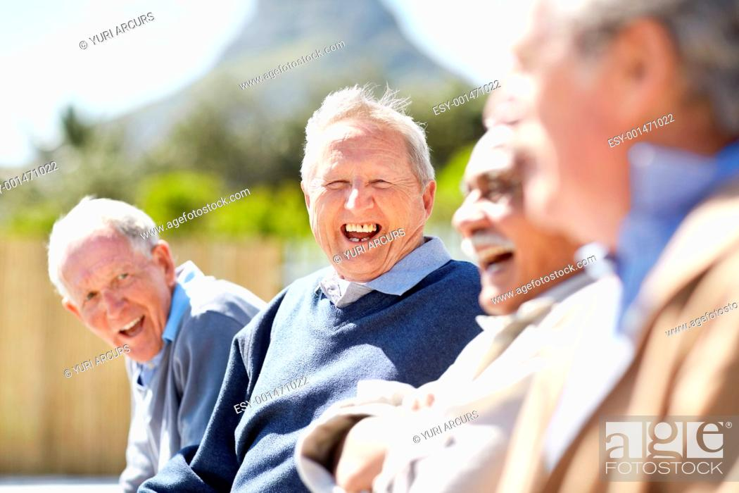 Stock Photo: Portrait of a happy senior man laughing with his friends - Outdoor.