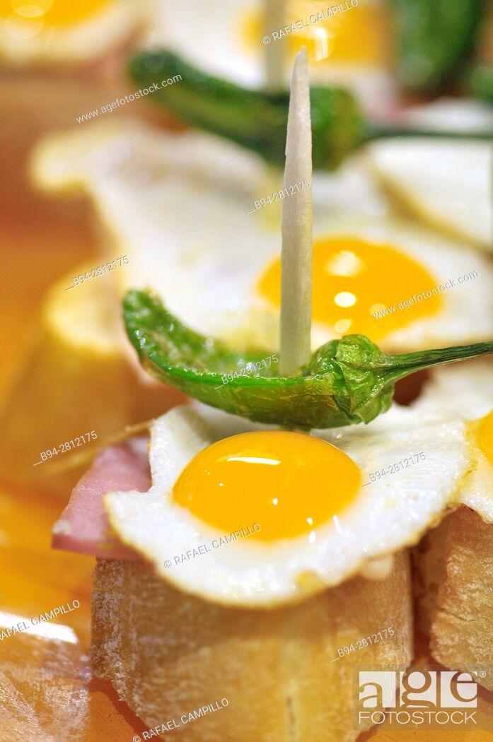 Stock Photo: Fried eggs with Green pepper. Pintxos or Tapas. Food very Typical in the Basque country. San Sebastián (Donostia), Gipuzkoa, Basque Country, Spain.
