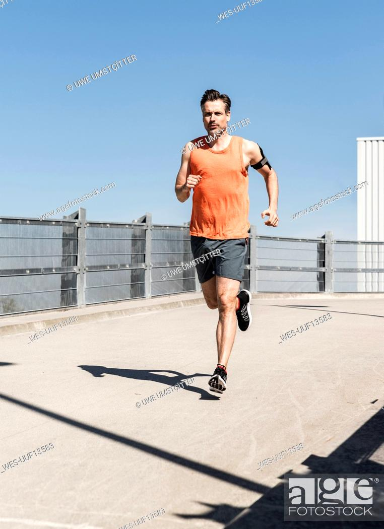 Stock Photo: Man jogging in the city.