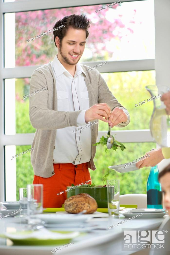 Stock Photo: Man tossing salad for lunch.