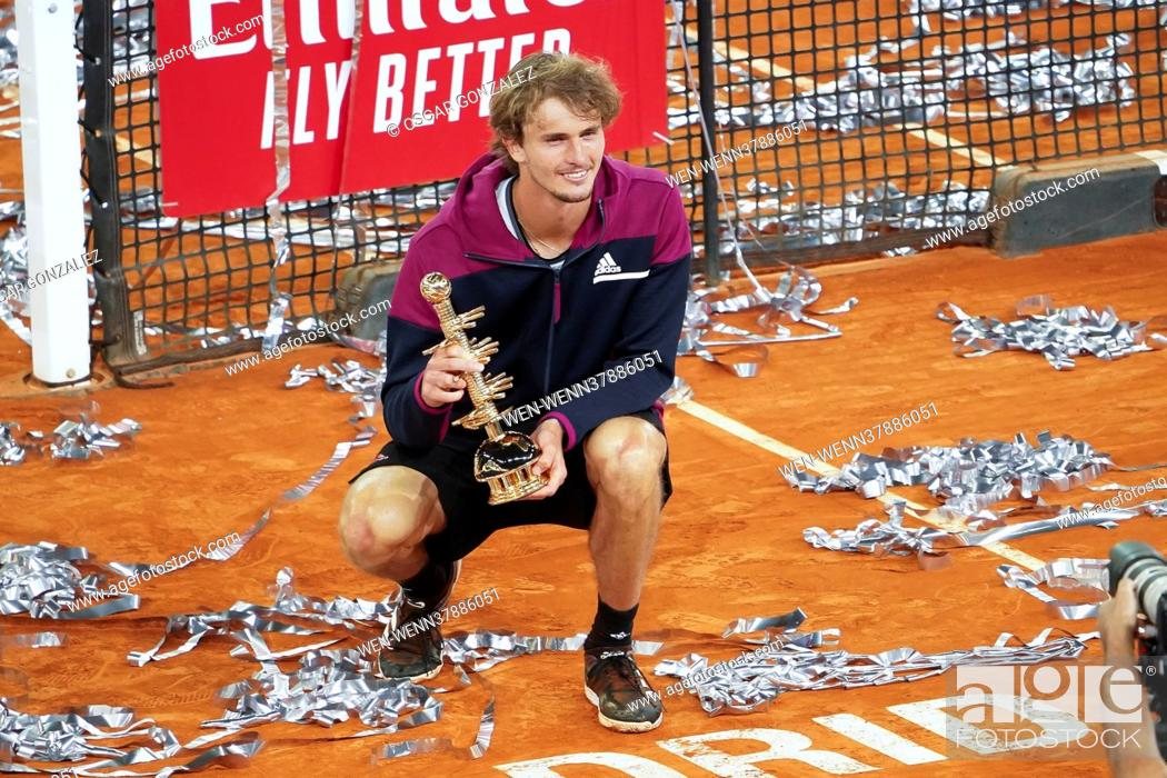Stock Photo: Alexander Zverev of Germany celebrates with the trophy following victory against Matteo Berrettini of Italy in the Mutua Madrid Open Final on day eleven of the.