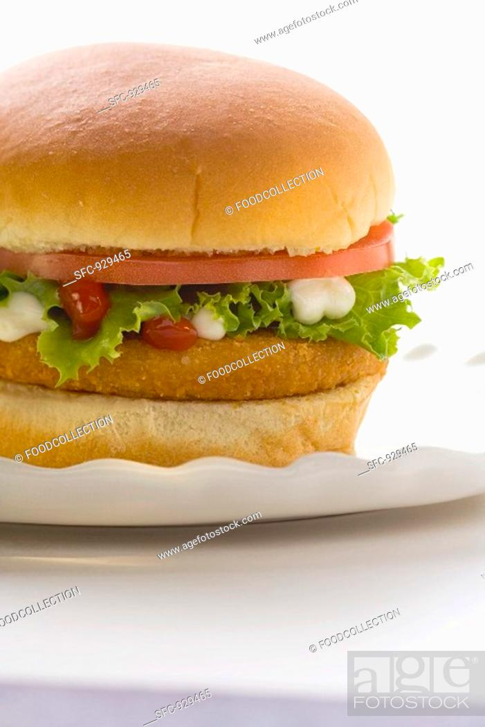 Stock Photo: Chicken burger with tomato, lettuce, mayonnaise & ketchup.