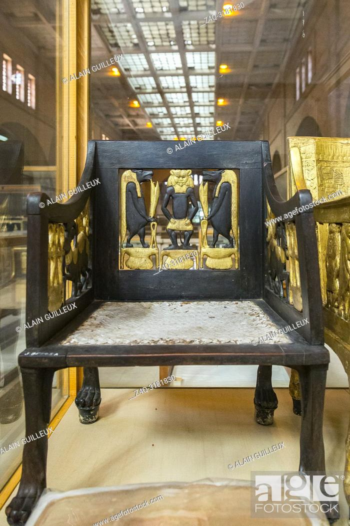 Stock Photo: Egypt, Cairo, Egyptian Museum, from the tomb of Yuya and Thuya in Luxor : Wooden chair, painted and gilded. The feet are lion paws, in silver.