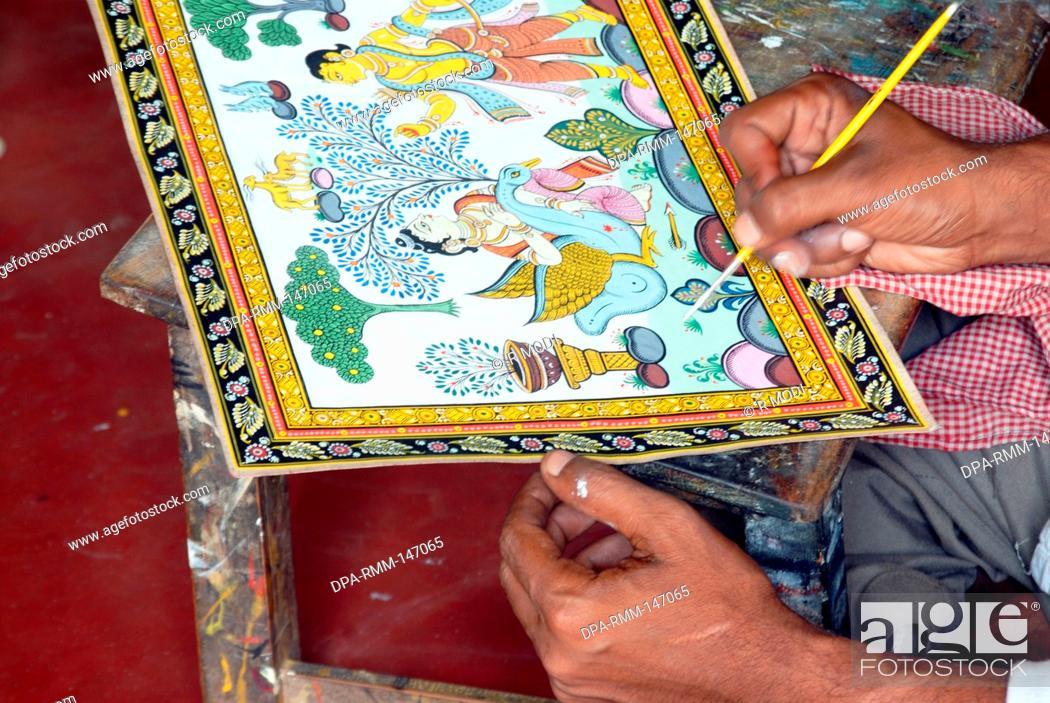 Men making painting