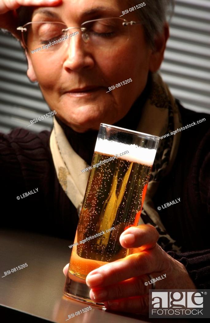 Stock Photo: ELDERLY PERSON DRINKING<BR>Model.