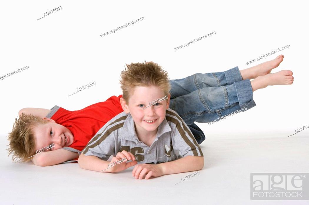 Stock Photo: Two boys on the floor.