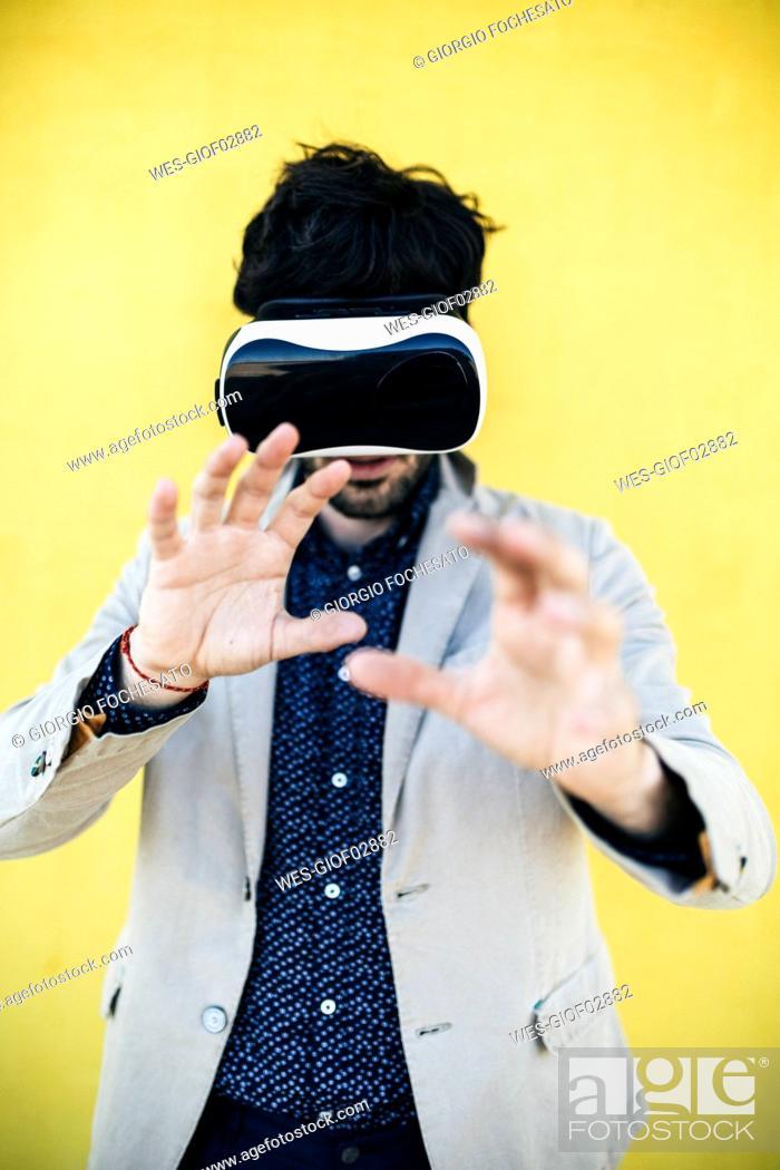 Stock Photo: Man wearing Virtual Reality Glasses.