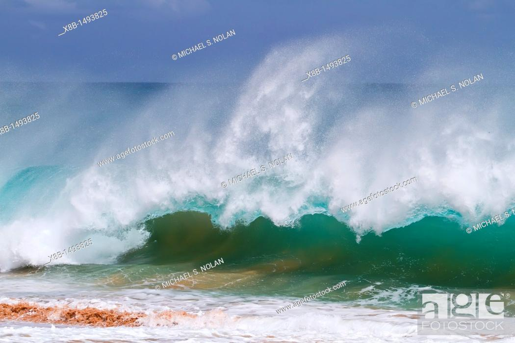 Stock Photo: HUGE waves breaking on the beach at Ascension Island in the Tropical Atlantic Ocean  MORE INFO Ascension Island is a remote volcanic island in the tropical.